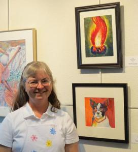 """Julie with her """"Campfire"""" watercolor painting at Instructor-Student Art Exhibit --BTAC"""