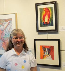 "Julie with her ""Campfire"" watercolor painting at Instructor-Student Art Exhibit --BTAC"