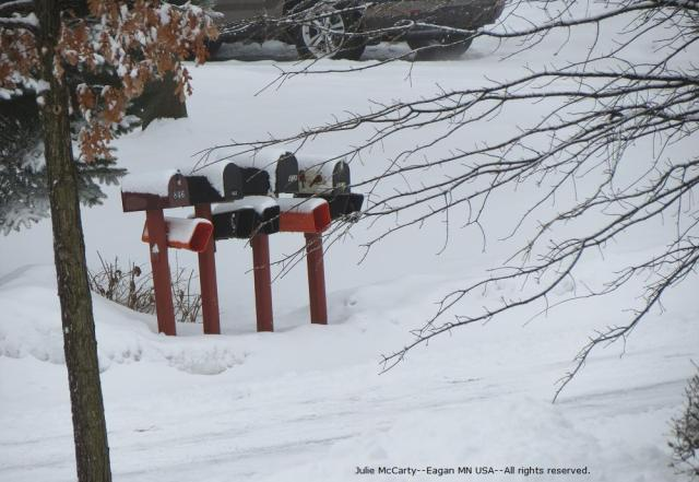 Mailboxes in snow--by Julie McCarty--Eagan MN USA